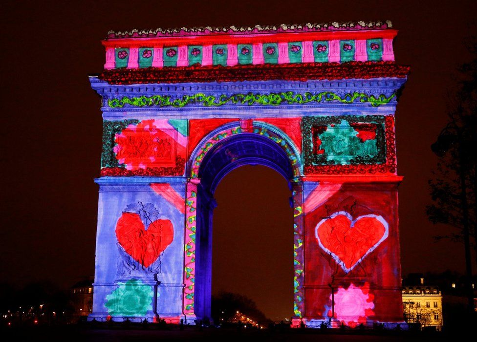 View of a light show on the city's iconic Arc de Triomphe monument during the New Year celebration in Paris, France