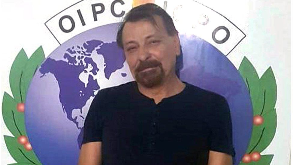 A handout photo made available by the Italian Ministry of Interior shows former communist militant Cesare Battisti after his arrest