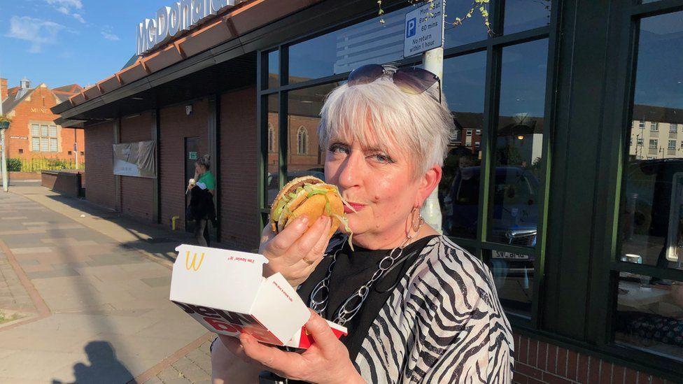 Caroline Aston eating a Big Mac