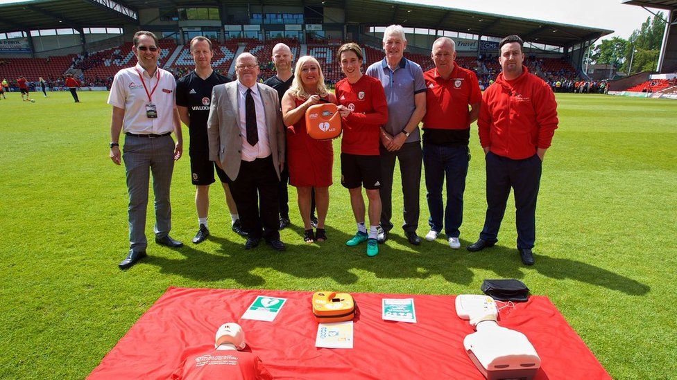 Harry Wilson and members of the FAW with a defibrillator