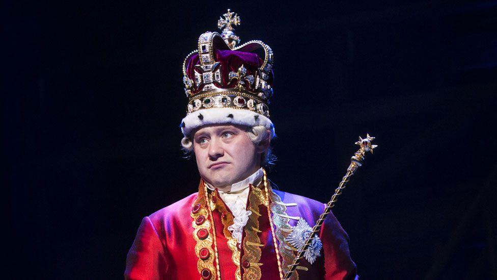 Michael Jibson as King George in Hamilton
