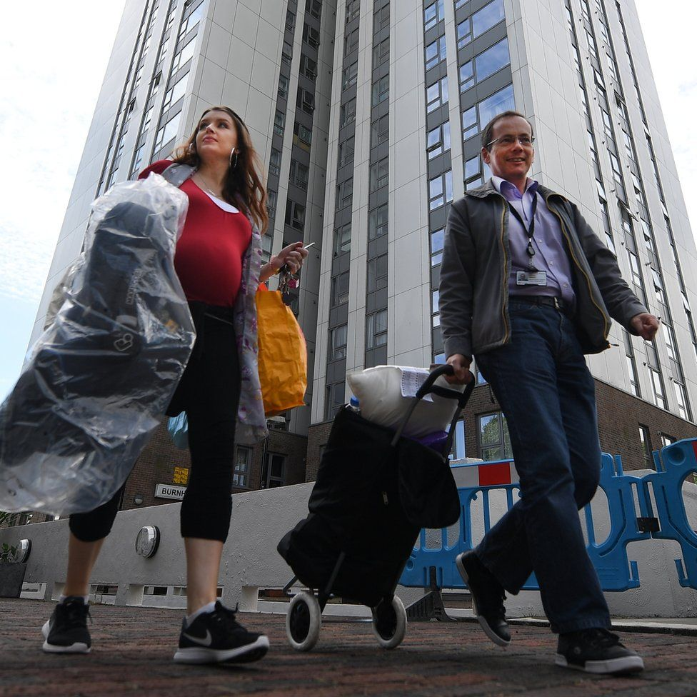 Residents leaving the Chalcots Estate in Camden, when the building was briefly evacuated over concerns about fire safety