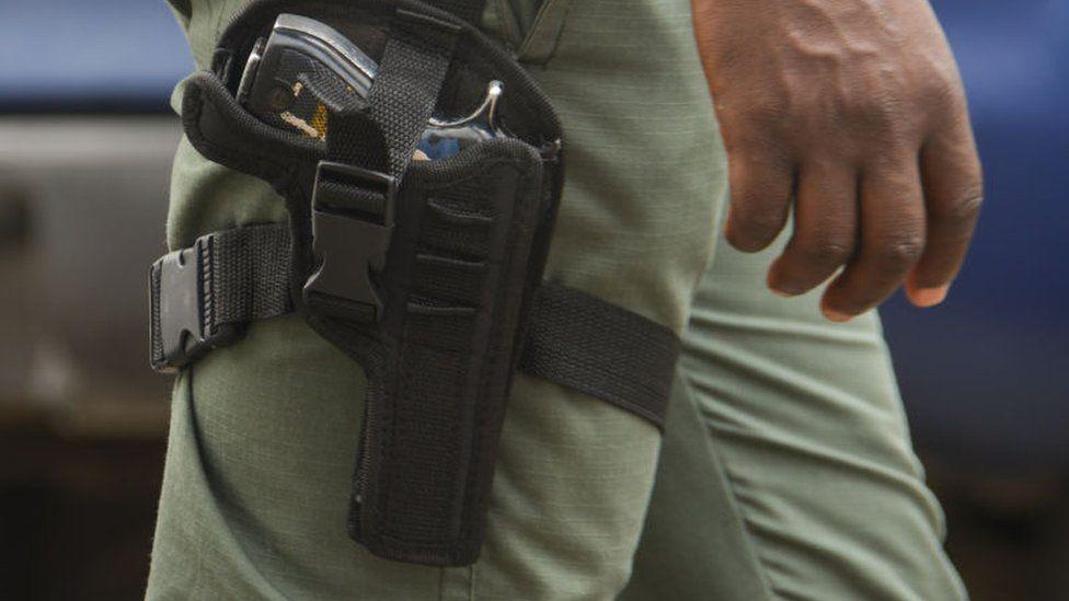 Officer with gun