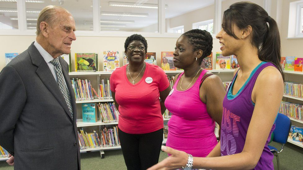 Prince Philip and volunteers at an east London community centre