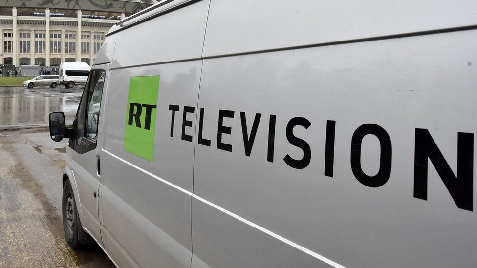 A Russia Today (RT) television broadcast van is seen parked in Moscow