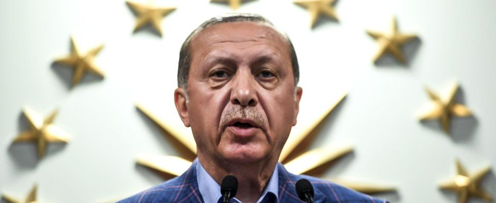 Turkish president Recep Tayyip Erdogan delivers a speech at the conservative Justice and Development Party (AKP) headquarters in Istanbul, on April 16, 2017, after the results of a nationwide referendum that will determine Turkey's future destiny.