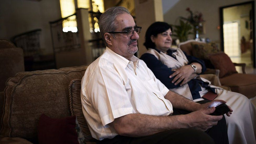 Ibrahim Sharif, chief of the Waed secular group, sits with his wife Farida Ghulam (R) at their home in the village of Tubli, south of Manama, on 20 June 2015