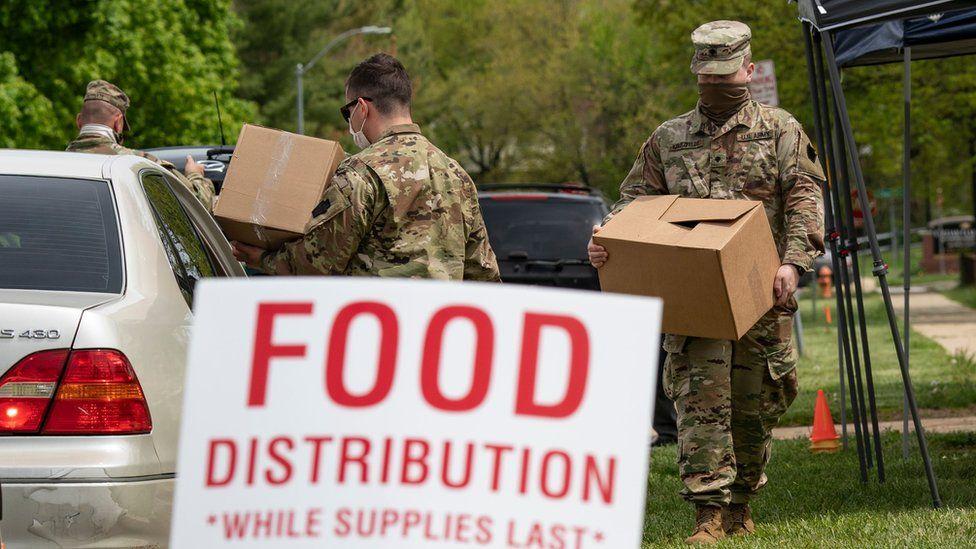 national guard members distribute food