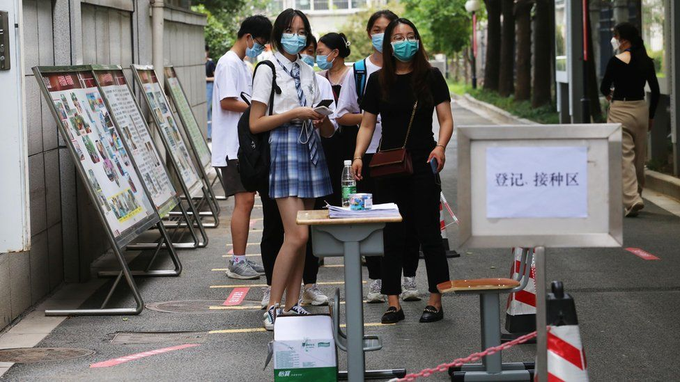 Students waiting for their jabs in China.