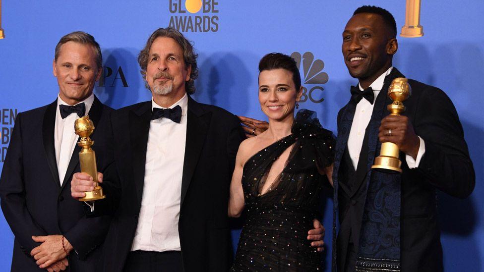 Green Book actor Viggo Mortensen, director Peter Farrelly, actress Linda Cardellini and actor Mahershala Ali with their Golden Globes