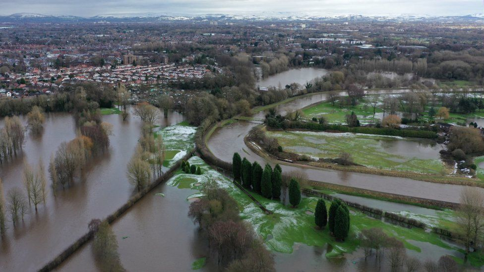 aerial view of Manchester with floodwaters and snow