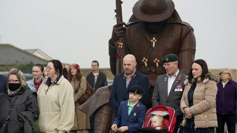 People attend a Remembrance Sunday ceremony at the Tommy statue on Terrace Green in Seaham, County Durham.