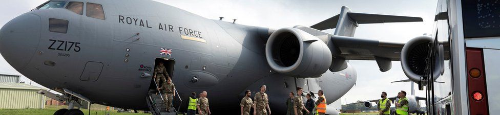 Military personnel arrive at RAF Brize Norton base after being evacuated from Afghanistan