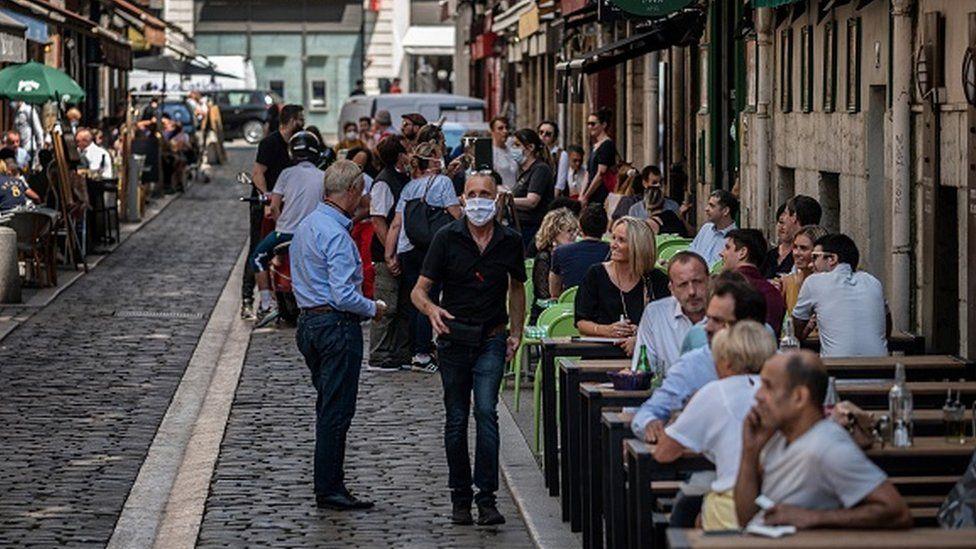 People eat in a restaurant in Lyon in June