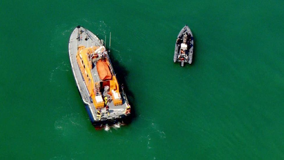 An RNLI lifeboat and a dinghy on Wednesday