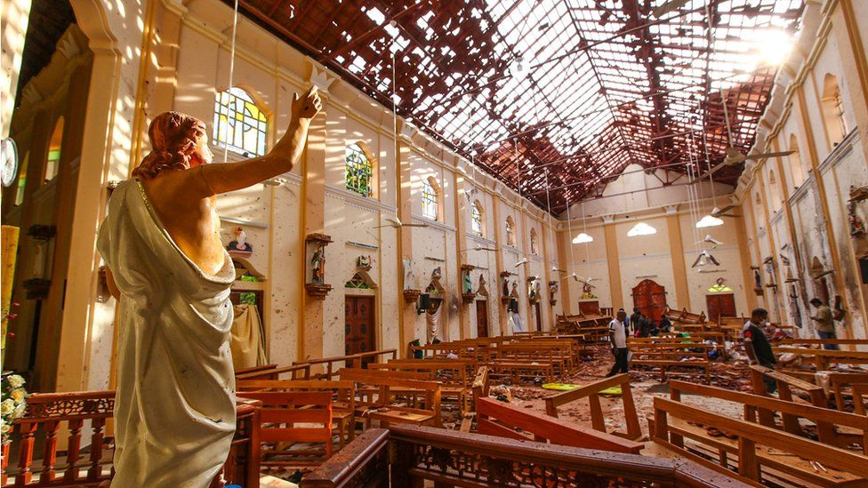 A statue of Jesus with his arm raised amid debris at St Sebastian's Church in Negombo, Sri Lanka following the Easter Sunday Bombing
