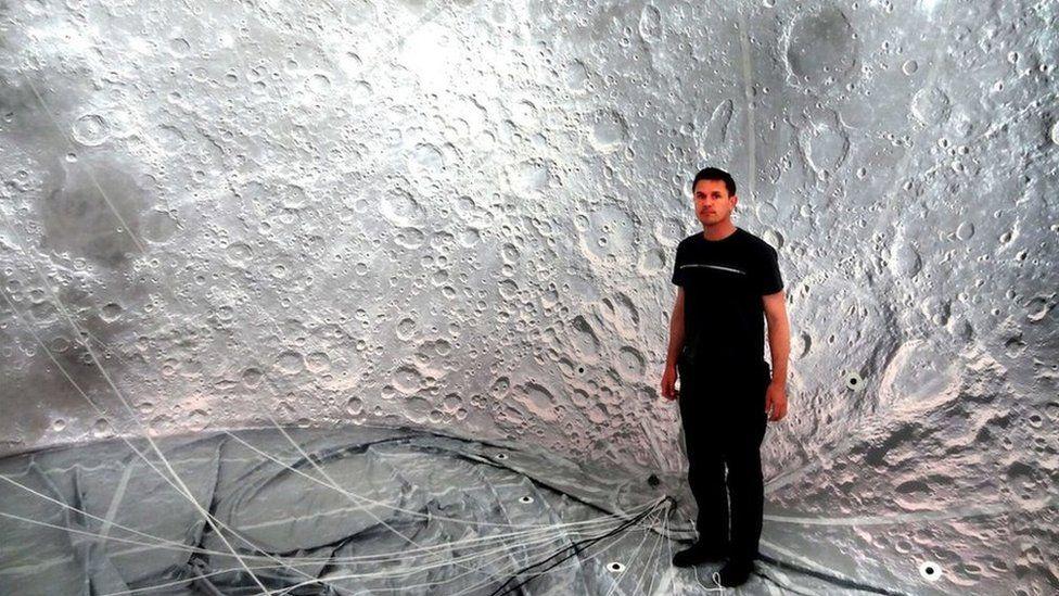 Artist Luke Jerram inside the moon balloon