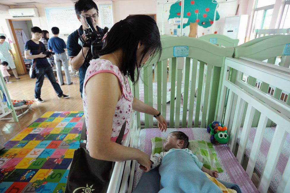 Jenna Cook visits the orphanage where she stayed in 1992