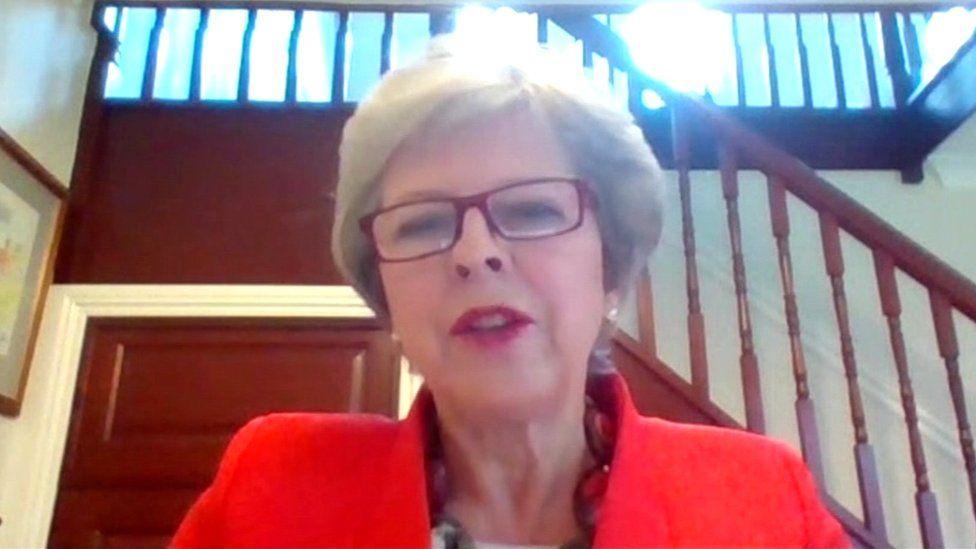 Theresa May speaking via video link