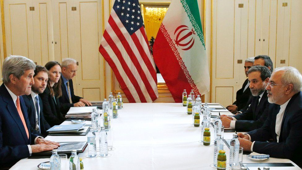 US Secretary of State John Kerry and Iranian Foreign Minister Javad Zarif, with other US and Iranian officials, meeting in Austria on 16 January 2016. The day the International Economic Energy Agency verified whether Iran had met all conditions under the nuclear deal.