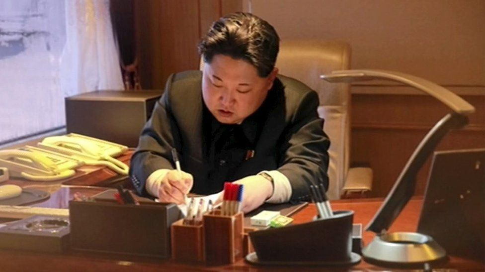 Kim Jong-un signs document regarding rocket launch, on 7 February 2016