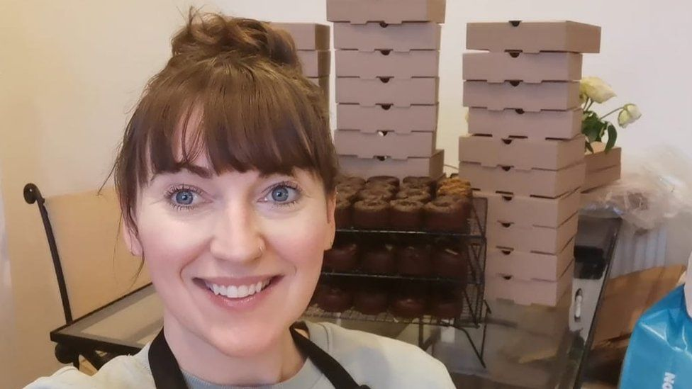 Ros Paterson in front of her boxes of bakes