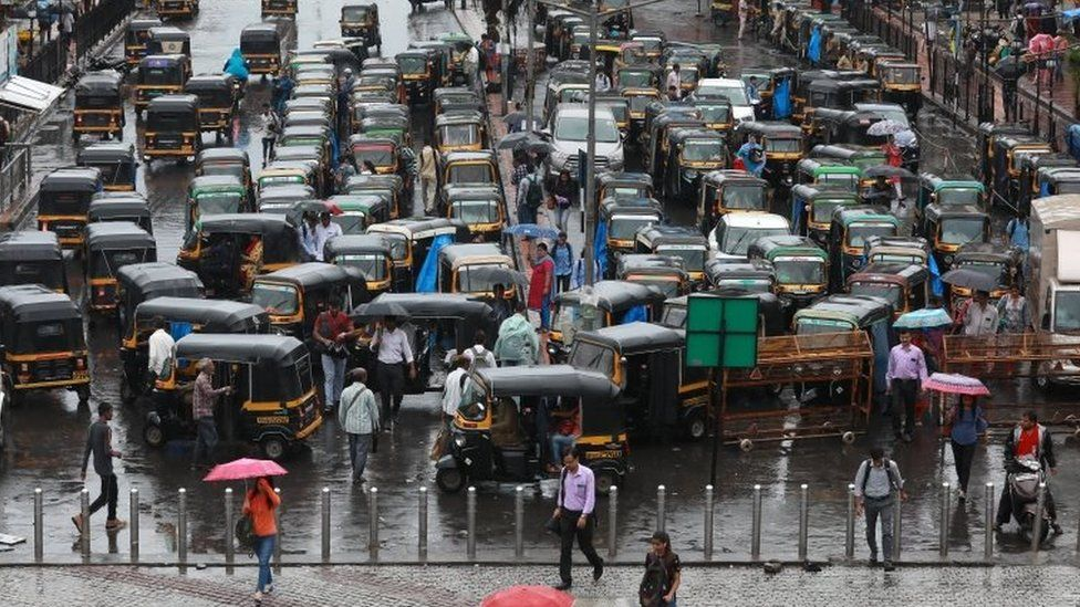 A general view of traffic during heavy rains in Mira road, near Mumbai, India, 01 July 2019.