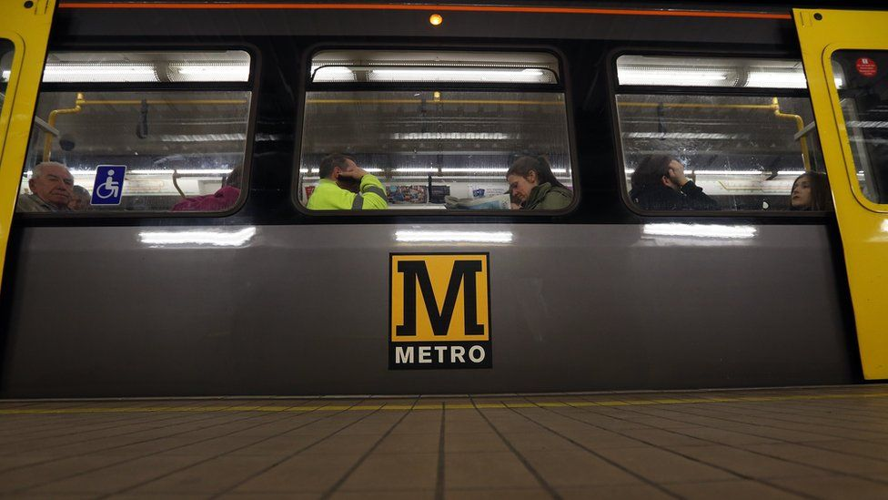 Passengers on a Metro carriage