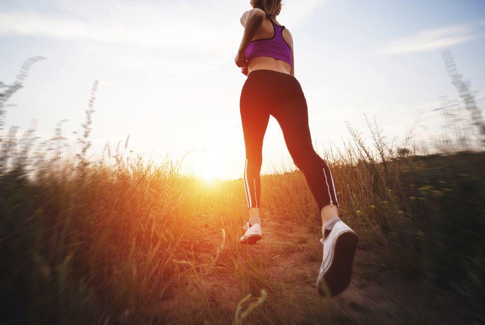 Woman running at sunset
