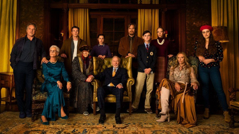 Christopher Plummer (seated front) with his fellow Knives Out cast members