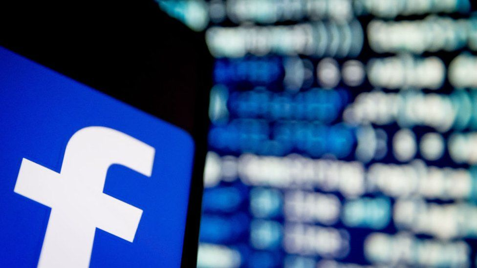 A photo illustration of a Facebook App logo is displayed on a smartphone in February 2020
