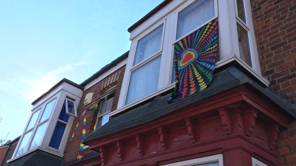 Flag draped outside window