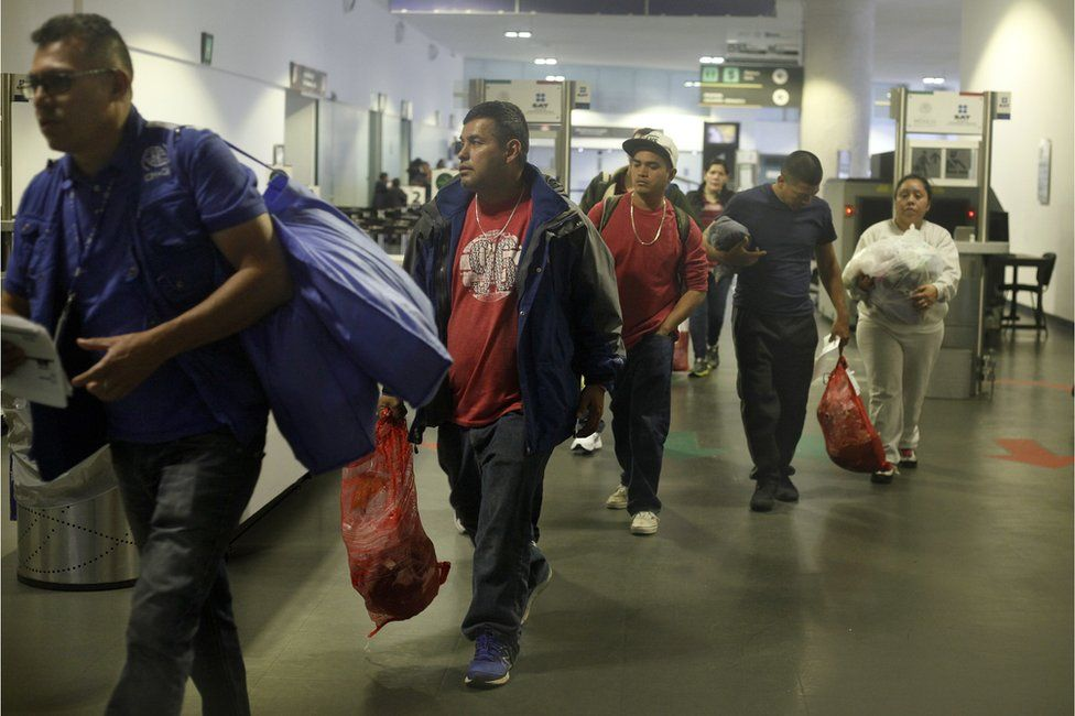 Mexican citizens arrive at the airport in Mexico City after being deported from the US, 23 February