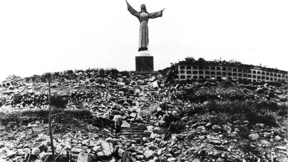 Statue of Christ at Cemetery Hill overlooking Yungay, which together with four palm trees, is all that remained of the city.