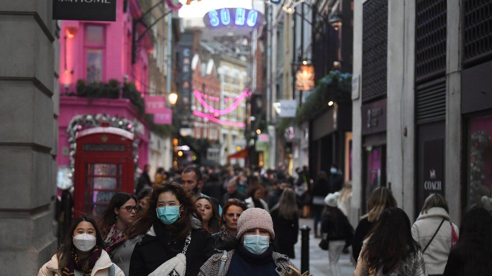 Shoppers make their way along Carnaby Street in London, Britain,