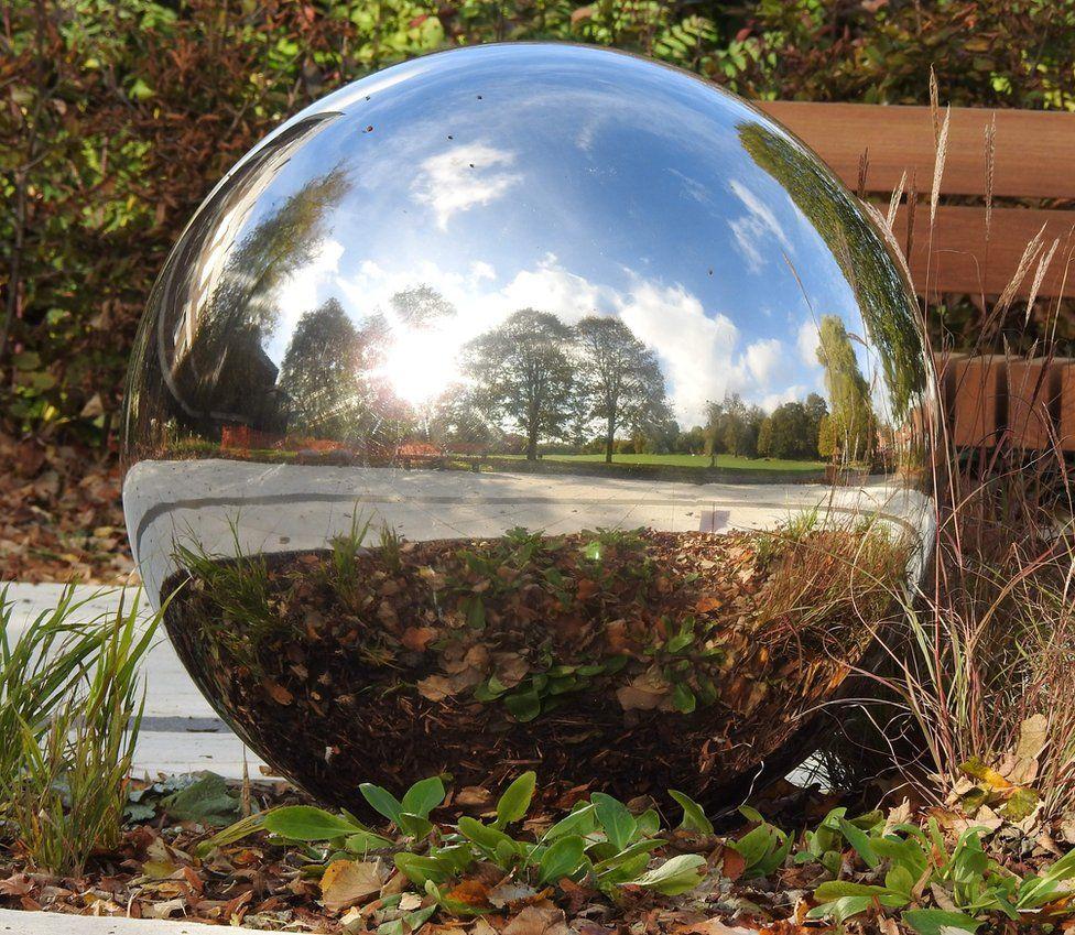 A reflective sphere sculpture