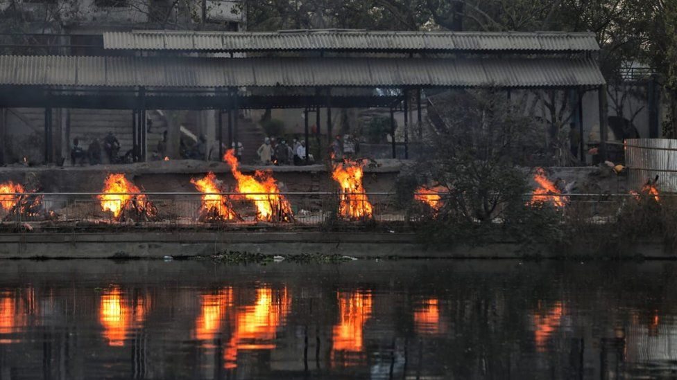 Burning funeral pyres at a crematorium in Lucknow city, ne of the worst-hit in India.