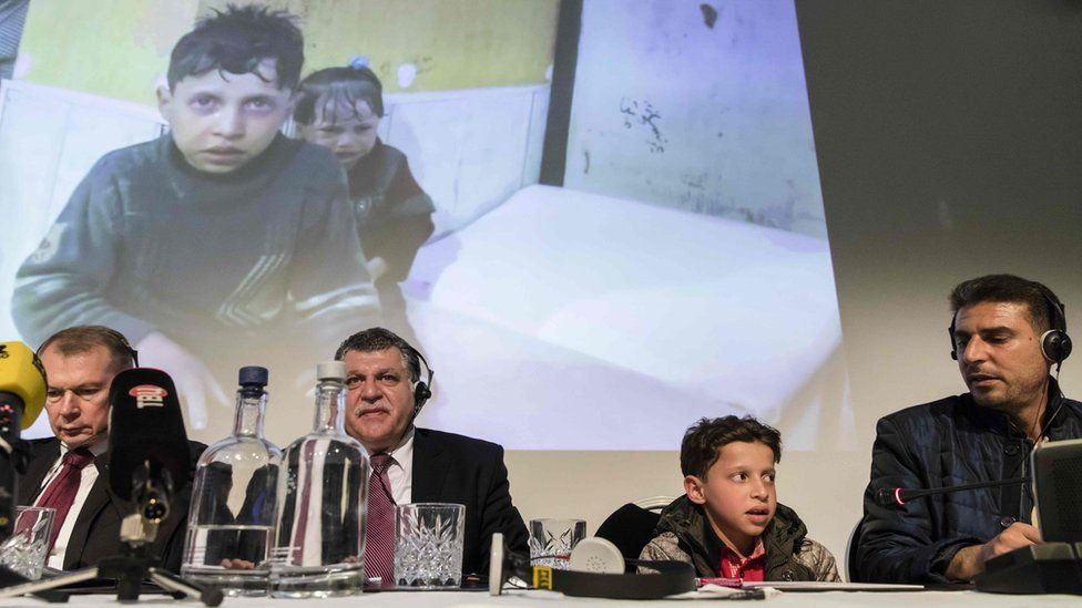 Russian officials at a press conference, alongside a boy pictured in the aftermath of the attack