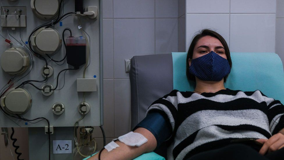 Kristina, (21years old) who recovered from COVID -19 donates her plasma via plasmapheresis method at the Regional Center of Blood Donation and Blood Treatment on November 10, 2020 in Krakow, Poland.
