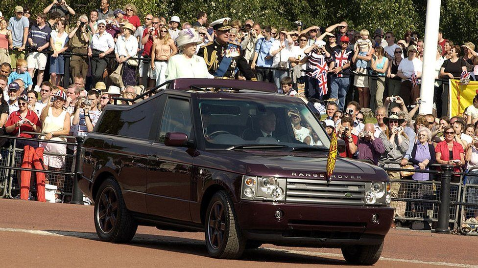 The Queen and Prince Philip in the back of a modified Range Rover on Commemoration Day