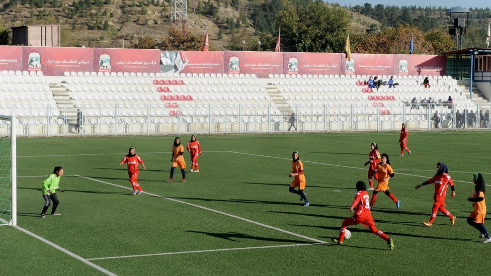 Afghan female football players vie for the ball during a football match in Kabul on November 9, 2013.