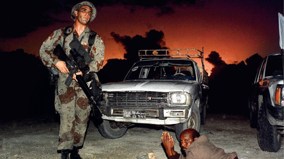 A US Marine orders Somalian man to the ground in Mogadishu, 1992