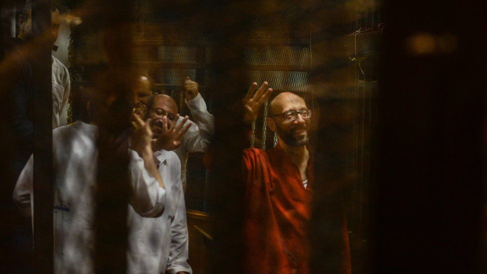 Ahmed Abdel Atei (R), head of ousted president Mohamed Morsi's office, along with other defendants flash the four-fingered salute associated with the Muslim Brotherhood, during a trial session in Cairo, Egypt, 18 June 2016