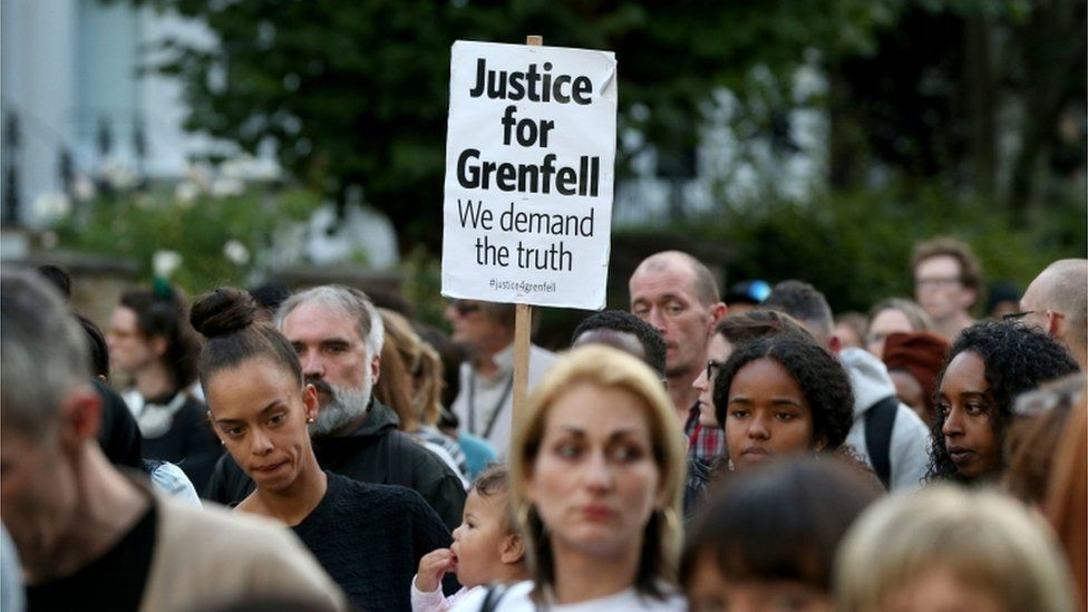 A silent march to pay respect to those killed in the Grenfell Tower disaster makes its way down Ladbroke Grove, London