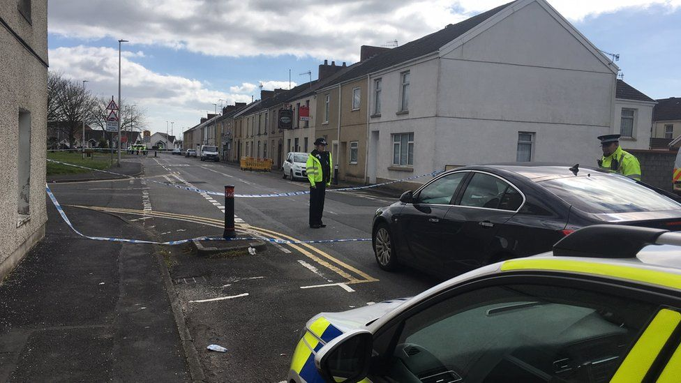 Police officers standing near Seaside square in Llanelli