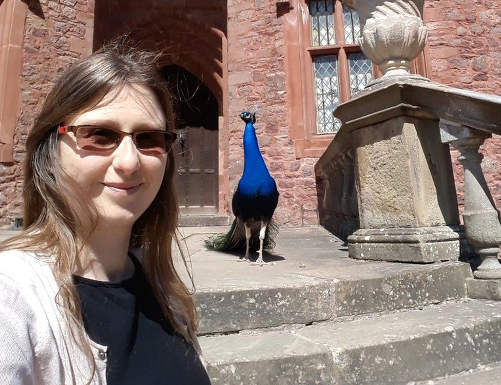 Sarah Johnson with a peacock