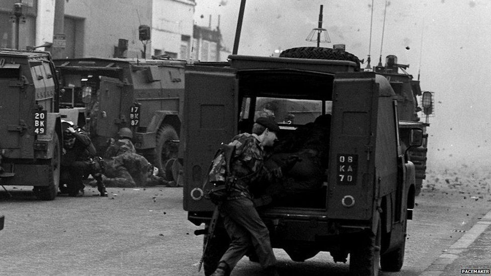 Soldiers taking cover under fire