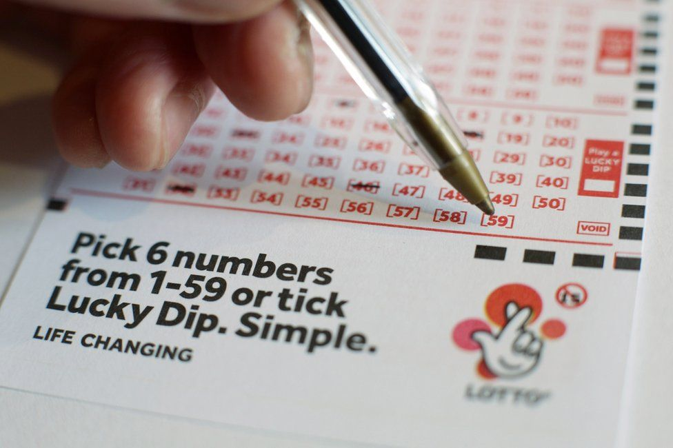 Person choosing lottery numbers