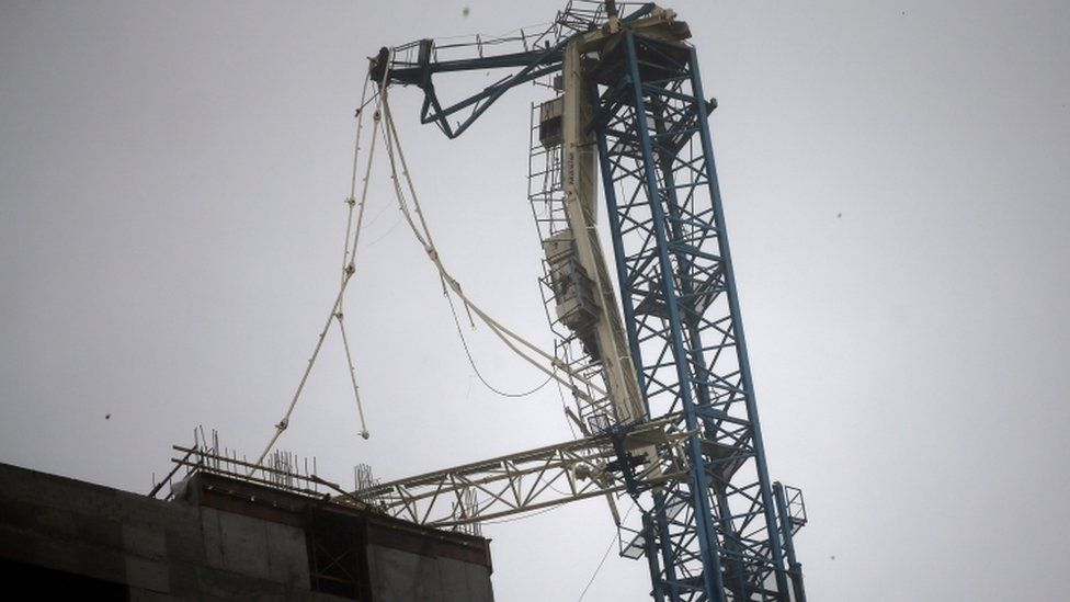 Broken crane is pictured in downtown Miami