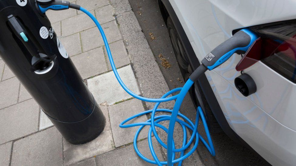 Electric car charging at charging point